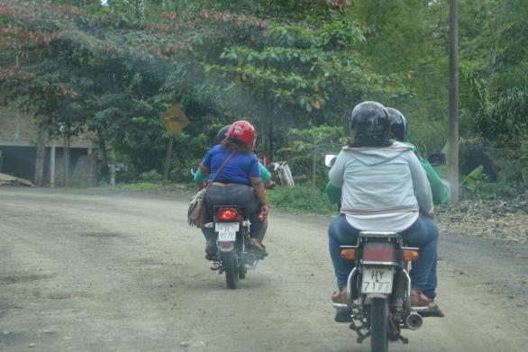 Men drives, women hangs on!
