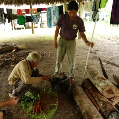 Shaman Don Sabino and Juan preparing Ayahuasca for their ceremony