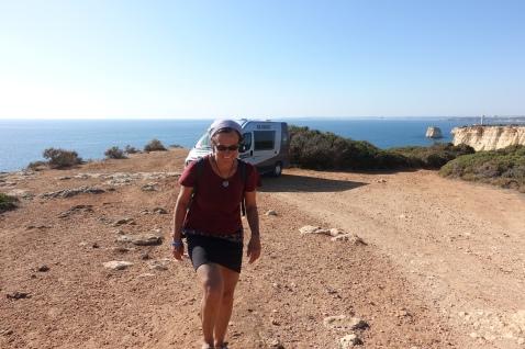 Small car, big cliffs.